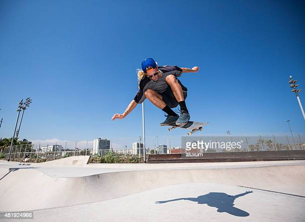 skateboarder jumping in skatepark - ollie pictures stock pictures, royalty-free photos & images