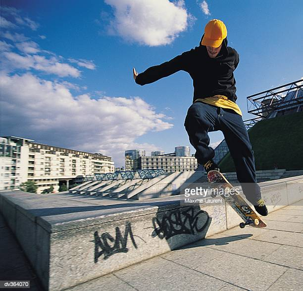 skateboarder jumping onto ledge - ollie pictures stock pictures, royalty-free photos & images