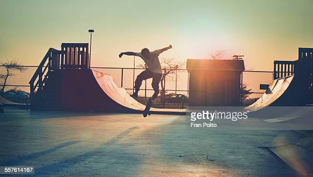 skateboarder jumping. - half pipe stock pictures, royalty-free photos & images