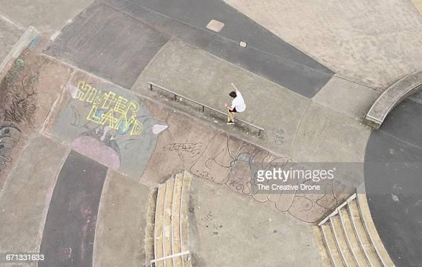 Skateboarder Jumping Rail