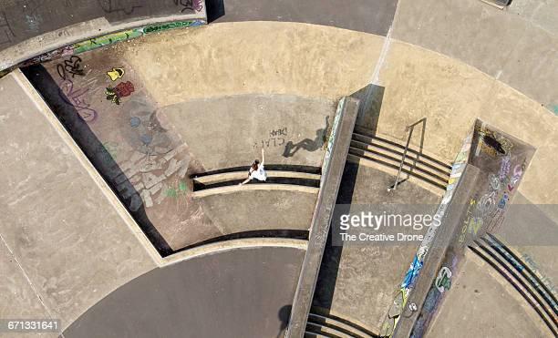 Skateboarder Jumping Stairs at Skatepark