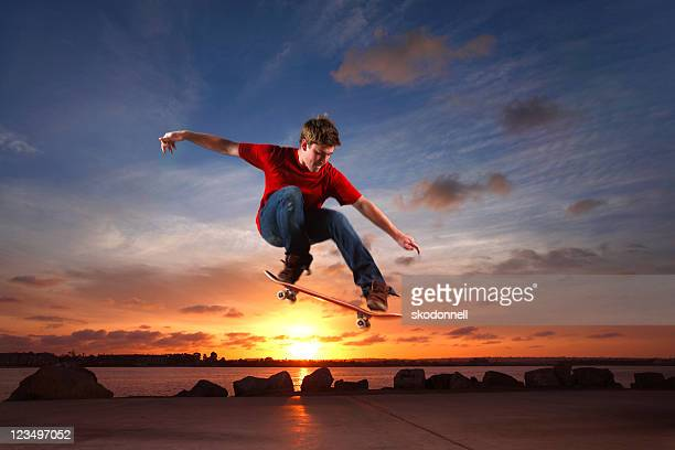 skateboarder leaping over the sun - ollie pictures stock pictures, royalty-free photos & images