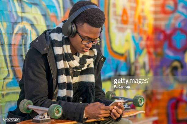 Skateboarder Listening to Music