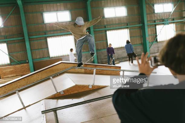 skateboarder making stunts on a ramp - ollie pictures stock pictures, royalty-free photos & images