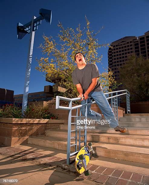Skateboarder on a railing