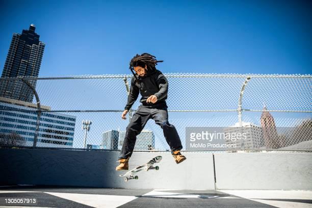 skateboarder performing trick in downtown atlanta - atlanta georgia stock pictures, royalty-free photos & images