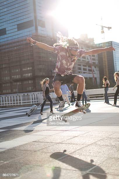 skateboarder performing trick in urban area - ollie pictures stock pictures, royalty-free photos & images