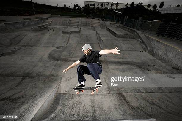 skateboarder performing tricks - ollie pictures stock pictures, royalty-free photos & images