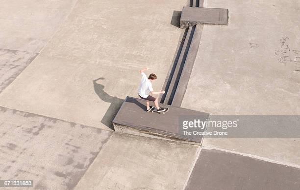 Skateboarder Performing Wheelie