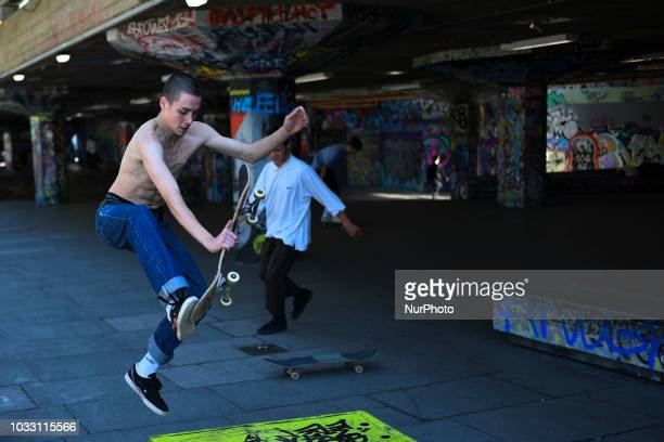 A skateboarder performs a trick at the skatepark in the Southbank area London on September 13 2018