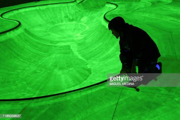A skateboarder performs inside the Triennale in a skatepark installation called OoooOoO by south korean artist Koo Jeon A and curated by Julia...