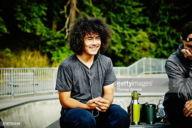 Skateboarder relaxing with friends in skate park