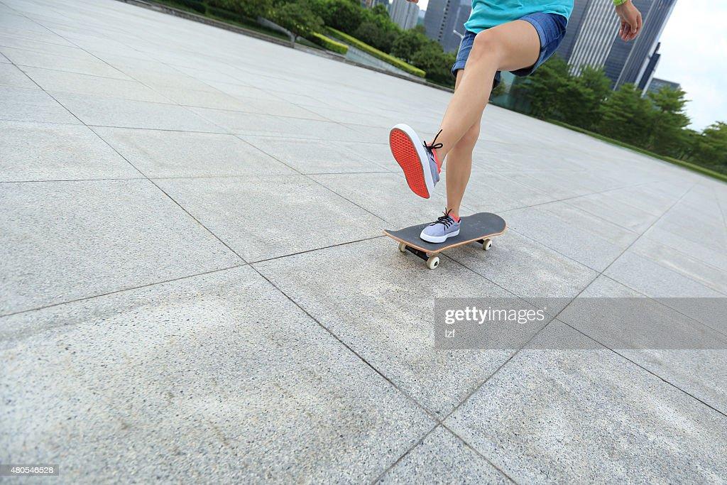 skateboarder skateboarding at  city : Stock Photo