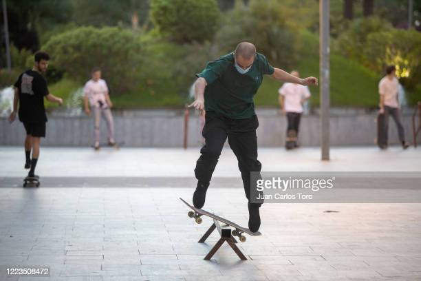 Skateboarder skates with a mask during the hours allowed for sports on May 07, 2020 in Jerez de la Frontera, Spain. Spain is opening businesses such...