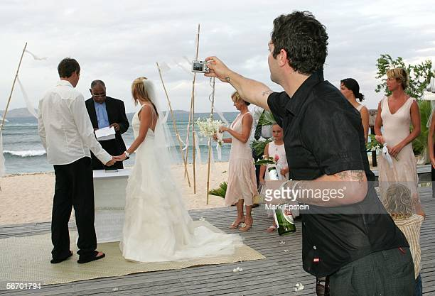 Skateboarder Tony Hawk and Lhotse Merriam are read their wedding vows while Bam Margera of 'Viva La Bam' snaps a photo January 12 2006 on the Island...