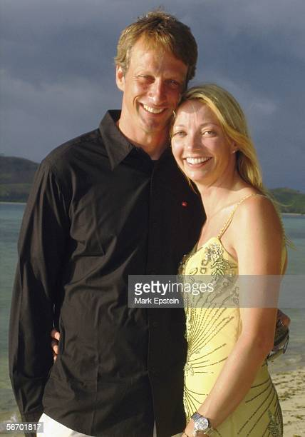 Skateboarder Tony Hawk and Lhotse Merriam pose for a photo at their welcome party January 11 2006 on the Island of Tavarua in Fiji