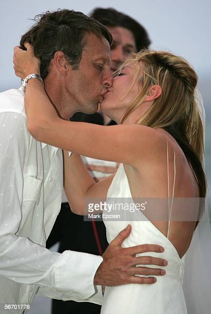 Skateboarder Tony Hawk and Lhotse Merriam share a kiss after their marriage January 12 2006 on the Island of Tavarua in Fiji