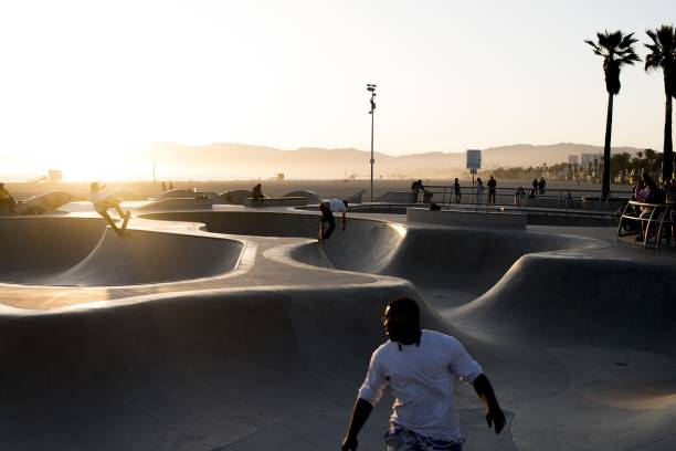 Skateboarders Enjoy The Venice Beach Skate Park At Sunset On May 31 2018 In Los