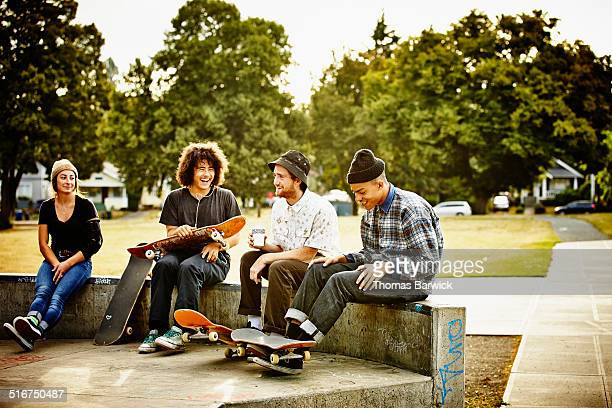 Skateboarders hanging out in skate park
