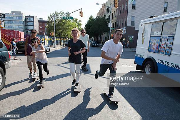 Skateboarders on urban street
