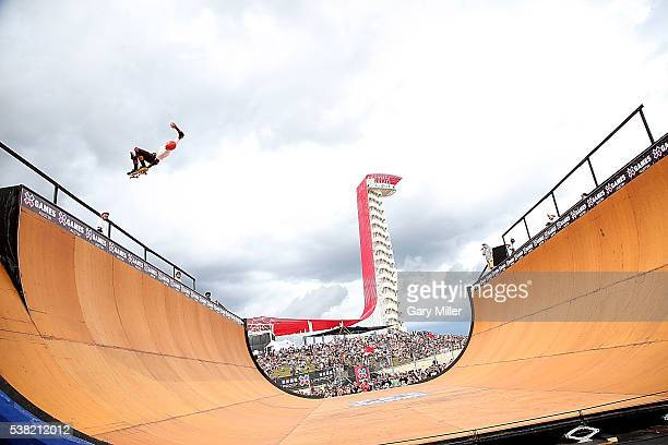 Skateboarders practice on the vert ramp during the X Games at Circuit of The Americas on June 3 2016 in Austin Texas