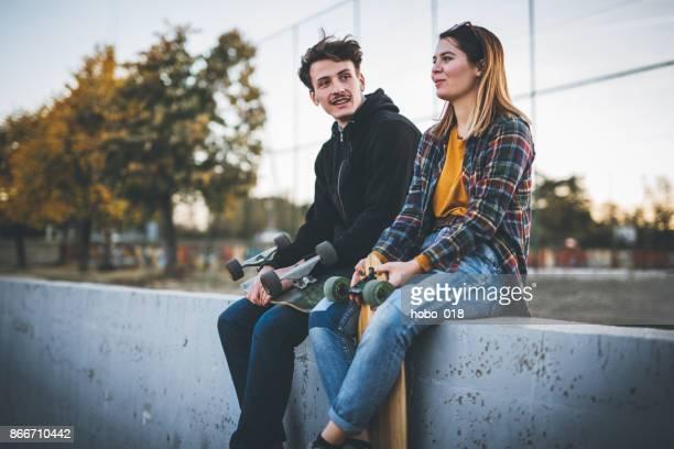 Skateboarders taking a rest in skate park