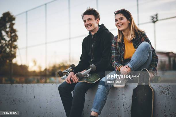 skateboarders taking a rest in skate park - stunt stock pictures, royalty-free photos & images