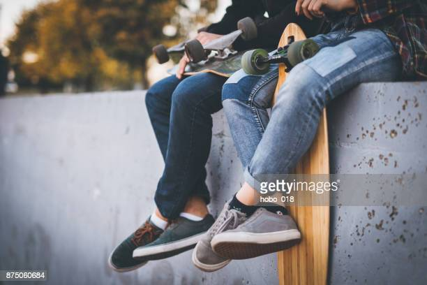 Skateboarders taking a rest in skate park