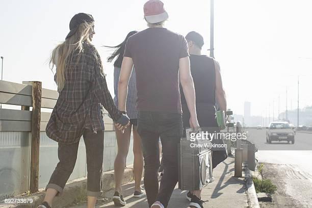 Skateboarders walking on street, Budapest, Hungary