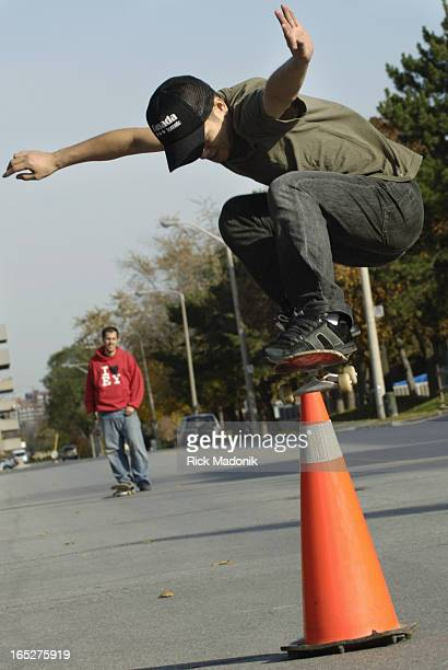 skateboarding 11/03/05 TORONTO ONTARIO Local skaters do their thing in public places and on streets Masaru Itake flies over a traffic cone while Nick...