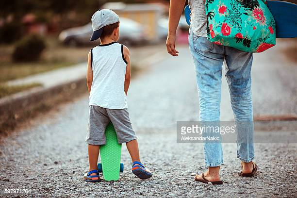 skateboarding family - mothers day beach stock pictures, royalty-free photos & images
