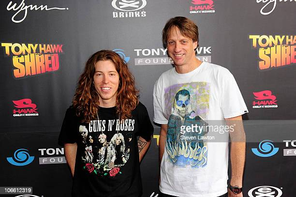 Skateboarding icon Tony Hawk and pro snowboarding Olympic gold medalist Shaun White arrive for Tony Hawk's stand up for skateparks benefit at Wynn...
