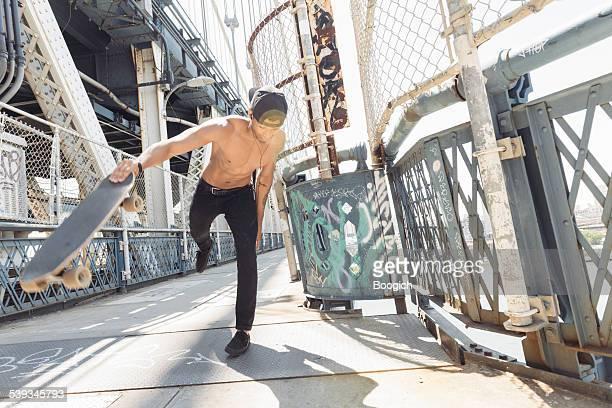 NYC Skateboarding Man Crossing Urban Manhattan Bridge Local Travel