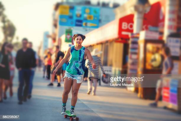 Skateboarding through Venice beach