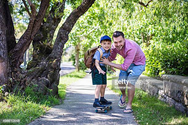 Skateboarding to school with daddy