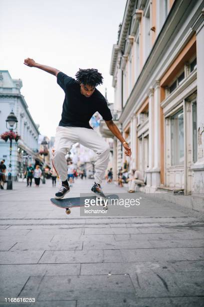 skateboarding tricks in downtown - ollie pictures stock pictures, royalty-free photos & images