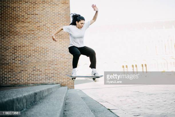 skateboarding young adult woman - ollie pictures stock pictures, royalty-free photos & images