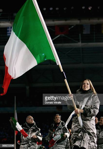 Skater Carolina Kostner carries the Italian flag during the Opening Ceremony of the Turin 2006 Winter Olympic Games on February 10, 2006 at the...