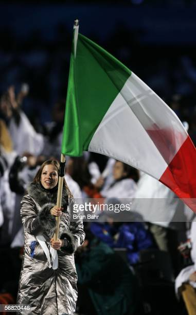 Skater Carolina Kostner carries the Italian flag during the Opening Ceremony of the Turin 2006 Winter Olympic Games on February 10 2006 at the...