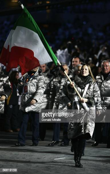 Skater Carolina Kostner carries the Italian flag in front of her team mates during the Opening Ceremony of the Turin 2006 Winter Olympic Games on...