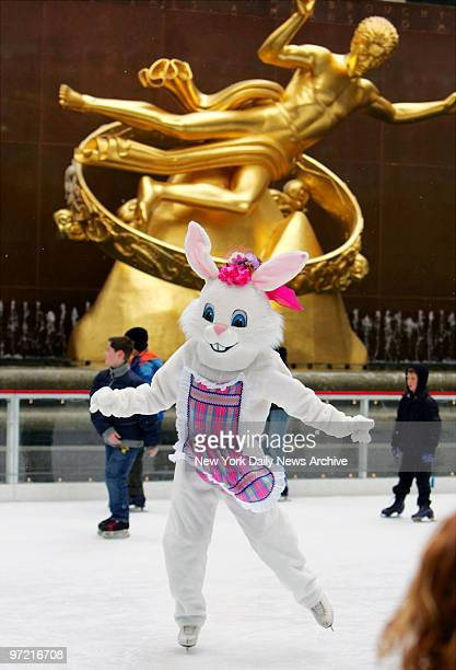 A skater dressed as the Easter Bunny glides on the ice at The Rink at Rockefeller Center on Easter Sunday