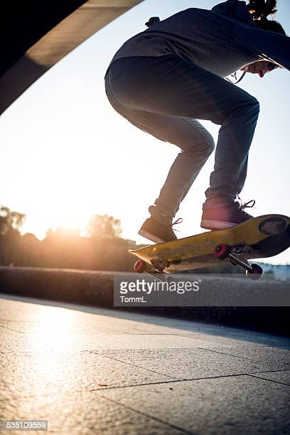 skater girl flipping skateboard - ollie pictures stock pictures, royalty-free photos & images
