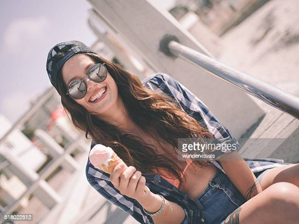 Skater girl hipster smiling outdoors with an ice cream
