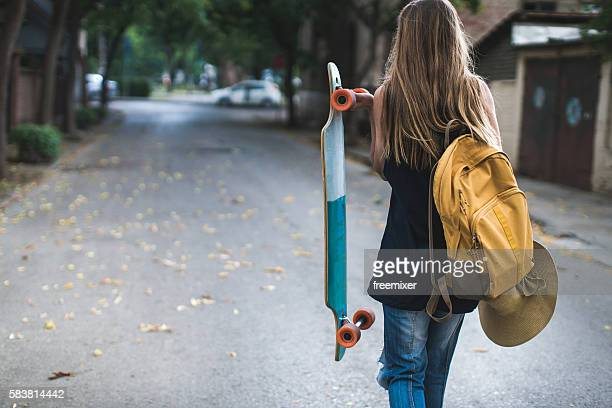 skater girl - longboard skating stock pictures, royalty-free photos & images