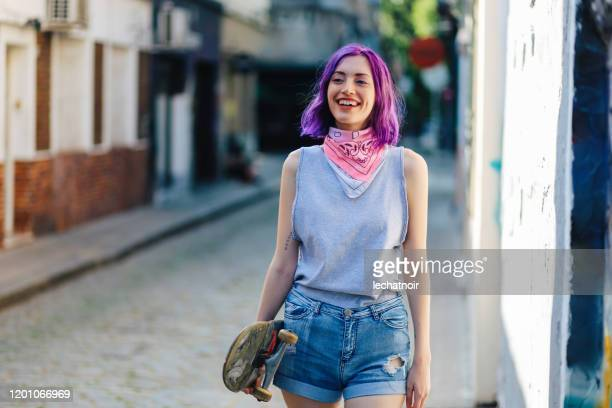 skater girl walking down the street in palermo, buenos aires - purple hair stock pictures, royalty-free photos & images