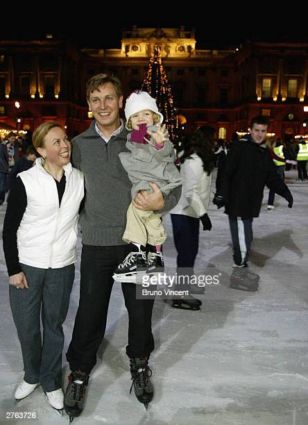Skater Jayne Torvill with ballerina Darcy Bussell's husband and daughter Angus Forbes and Phoeby attend the Somerset House Christmas Ice Rink launch...