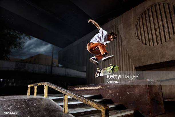 Skater jumping on his skate in skatepark