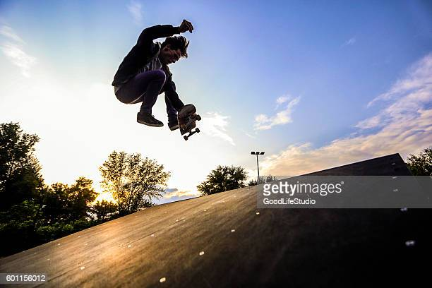 skater jumping - skating stock photos and pictures