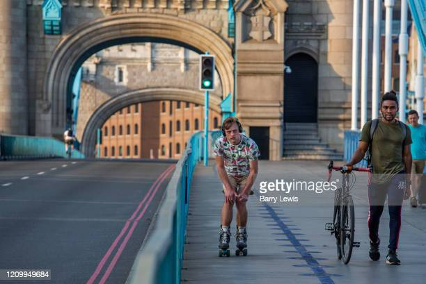 Skater keeping fit while practicing social distancing during the lockdown on Tower Bridge at 5pm on 9th April 2020 in London, United Kingdom....