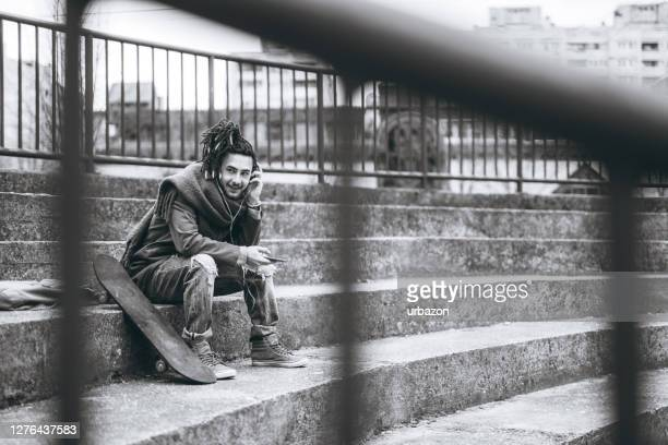 skater listening to music - borough district type stock pictures, royalty-free photos & images